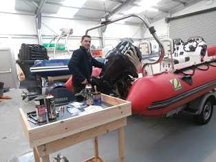 Jody working on a Yamaha Outboard