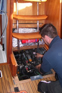 Jody working on another Yanmar 3YM inside a Southerly 100